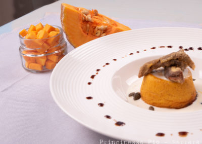Foto_Piatti_Flan di zucca violina con crema di Parmigiano Reggiano e funghi porcini